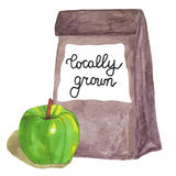 Cultivé sur place Sac de papier de Brown avec la pomme et le lettrage Photographie stock libre de droits