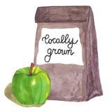 Cultivado localmente Bolsa de papel de Brown con la manzana y las letras Fotografía de archivo libre de regalías