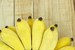 Cultivate Asian yellow banana on wood background. Stock Image