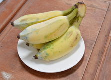 Cultivated banana on dish Stock Images
