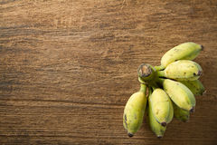 Cultivated banana on wooden background. Cultivated banana contain high calorie and Iron useful for healthy. Stock Image