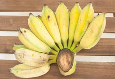 Cultivated banana in wooden table. Royalty Free Stock Photography