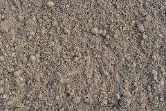 Cultivated brown soil surface Royalty Free Stock Photo