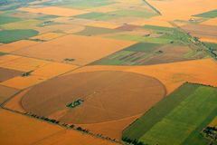 Cultivated farmland. Aerial view of farmland with a mosaic of cultivated land and planted crops royalty free stock images