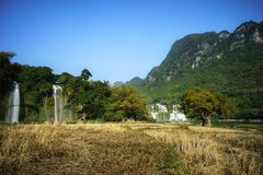 Cultivated farmland in dry season in Cao Bang province with Ban Gioc waterfall in north of Vietnam.  Royalty Free Stock Photo