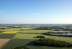 Cultivated field from above. Aerial view of meadows and cultivated fields. Birds view. Arable land Royalty Free Stock Photos