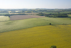 Cultivated field from above. Aerial view of meadows and cultivated fields. Birds view. Arable land Royalty Free Stock Image