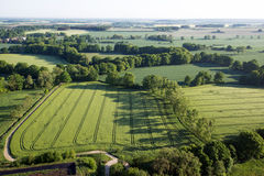 Cultivated field from above. Aerial view of meadows and cultivated fields. Birds view. Arable land Stock Images