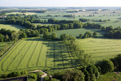 Cultivated field from above. Aerial view of meadows and cultivated fields. Birds view. Arable land Stock Image