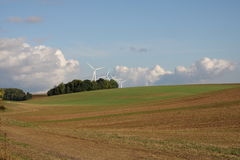 Cultivated field and wind turbine in Champagne Stock Photos