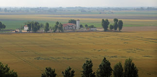 Cultivated fields in the vast Po Valley in central Italy. Panorama of cultivated fields in the vast Po Valley in central Italy Royalty Free Stock Image