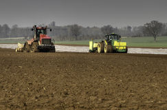 Cultivating land and drilling Maize Royalty Free Stock Photo