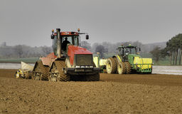 Cultivating land and drilling Maize Stock Photography