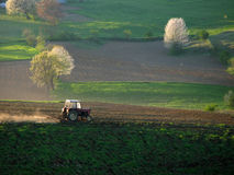 Cultivating the landscape. With tractor, near Cazin, Bosnia Stock Photography