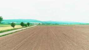 Ploughed field aerial video. Farm field. 4K Drone Flight. stock video footage