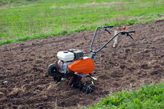 Cultivator on field. Royalty Free Stock Photography