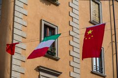 Cultrual diversity on display as both the Italian and Chinese flags fly over the newest trendy China town section in Milan, Itlay. Stock Photos