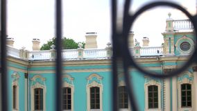 Cultural building facade. Defocused black fence close up stock video