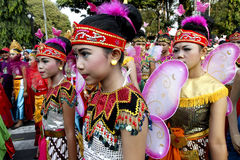 Cultural carnival. Children dressed in various costumes while attending cultural carnival in the city of Solo, Central Java, Indonesia stock image
