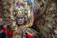 Cultural Carnival Participants Wearing Eagle Costumes. 11/02/2018, Solo, Central Java, Indonesia: Cultural carnival participants wearing eagle costumes at Lunar Royalty Free Stock Image
