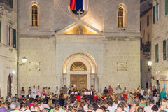 Cultural concert in front of the church Stock Photos