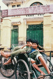 Cultural Continuation:Cyclo drivers in Hanoi, Vietnam, at rest Royalty Free Stock Photos