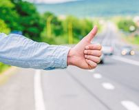 Cultural difference. Thumb up inform drivers hitchhiking. But in some cultures gesture offensive risk to be killed by. Furious driver you just insulted royalty free stock photography