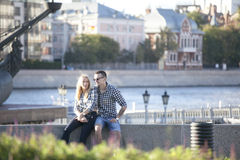Cultural diversity in Moscowy - couples walking the waterfront p Stock Image