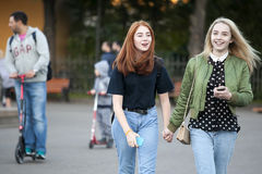 Cultural diversity in Moscowy - teens walking the waterfront pr Royalty Free Stock Photography