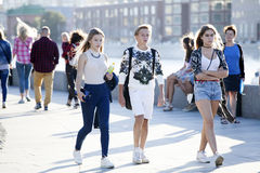 Cultural diversity in Moscowy - teens walking the waterfront pro Stock Photo