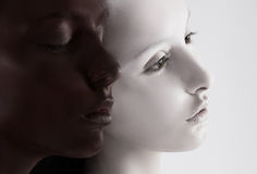 Cultural Diversity. Two Faces Colored Black & White. Yin Yang Style. Couple of Women Colored Black & White Royalty Free Stock Photo