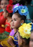Cultural festival. A child wearing patterned vegetation in a cultural festival in the city of Solo, Central Java, Indonesia Stock Image