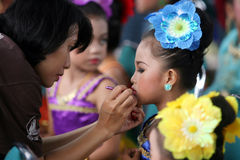 Cultural festival. A child wearing patterned vegetation in a cultural festival in the city of Solo, Central Java, Indonesia Royalty Free Stock Photography