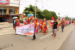 Cultural Festival Manokwari 2017. Group of people in traditional costumes from South Sulawesi walking and dancing on a parade. First ever Art and Cultural Stock Photo