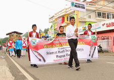Cultural Festival Manokwari 2017. Smiling happy boys from Northern Maluku on a parade. They are wearing typical cap or fez. First Cultural Festival in Manokwari Royalty Free Stock Images