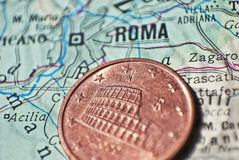 Cultural heritage concept. Italian coin 5 euro cents with coliseum on a map with the city of Rome, macro shot Stock Photo