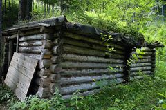 Cultural - historical monument: partisan victualling-yard in the Besna locality in the Ilanovska valley in Liptov. National cultural monument of Slovakia royalty free stock image