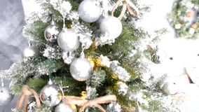 Cultural tradition - Christmas tree made of artificial materials with toys. Balls and stars stock video