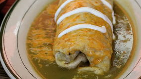 Cultural wet burrito and salsa green verde salsa stock footage
