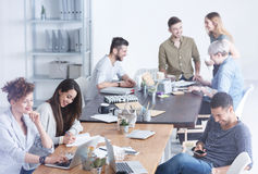 Culturally diverse team of employees. Enjoying their time on a break stock image