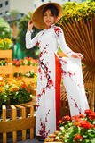 Culture Asia. Asian Woman In Traditional Dress ( Clothes ), Coni. Culture Of Asia. Beautiful Happy Smiling Young Asian Woman Wearing Traditional White Ao Dai Royalty Free Stock Photo
