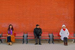 Culture of the Chinese people, people sit on a bench in China . stock images