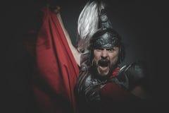 Culture, légionnaire romain prétorien et manteau, armure et swo rouges Photos libres de droits