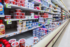 Cultured dairy products aisle in an American supermarket. Cultured milk products, known to mankind since antiquity, play an important role in the American diet Stock Photo