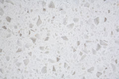 Cultured Granite Background Closeup. Closeup of a piece of cultured or composite granite, made from stone chips in a synthetic resin Stock Photos