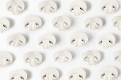 Cultured mushrooms on white background. Seasonal vegetables in hipster style pattern Royalty Free Stock Photography