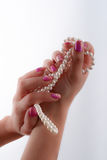 Cultured pearls and nail art Stock Photos