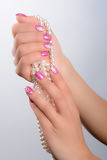 Cultured pearls and nail art Royalty Free Stock Photography