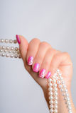 Cultured pearls and nail art Royalty Free Stock Photos
