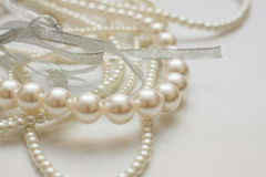 Cultured pearls on white. Background shallow dof Stock Image